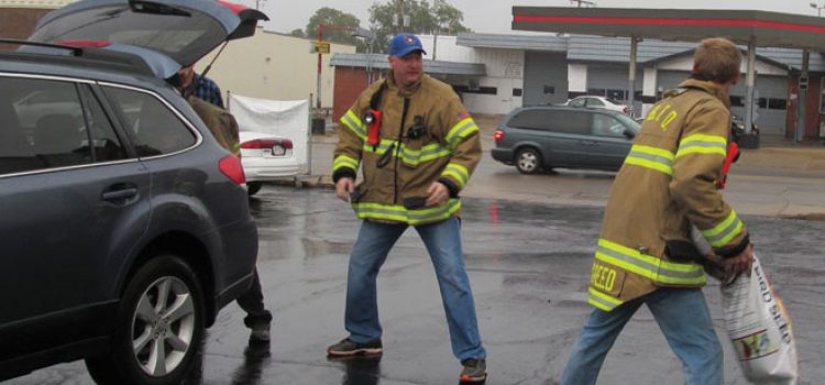 Local Fire Department Helps With Annual Birdseed Sale