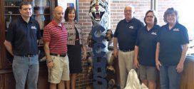 Store Donates Sculpture to Local School