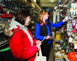 Willow Yoder, general manager of Greenwood Hardware, helps a customer from the segment the store most serves -- women.