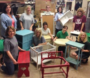 Attendees of Hardin True Value's chalk paint workshop, which is taught by co-owner Brenda James, display their finished pieces.