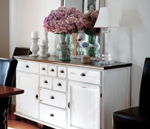 Photo courtesy of orphanswithmakeup.com. This piece is an old dark walnut dresser that was refinished with white chalk paint to add a fresh and bright look. A special technique was used to create a distressed feel.