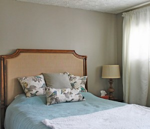 Photo courtesy of Courtney Guggenberger of coffeewithcake.com. This bedroom uses neutral hues, specifically gray, to highlight the blue accents.