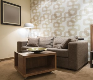 Wallpaper is no longer reminiscent of the '70s, as bold, geometric wallpaper now provides a unique focal point in a room.