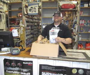Billy Marquette, parts manager for Klem's in Massachusetts, packs a box to fulfill an online parts order.