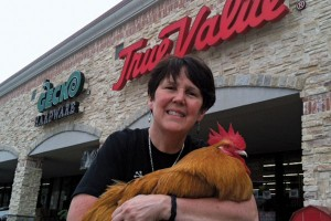 Andrea Ridout, managing partner of Gecko Hardware, uses George, the store's pet rooster and mascot, for promotional material.