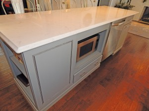 Having a microwave installed in base cabinets is nice for wheelchair clients but may not be the best choice for others who have to bend down to reach it.