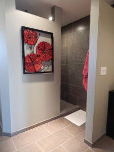 This walk-in shower was designed without a door or glass by Von Tobel Lumber & Hardware. There is space for a seat and grab bars.