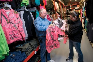 Marty Hornacek, owner of Northwoods Wholesale Outlet, identifies pink camo as a booming trend in the ladies' clothing department.