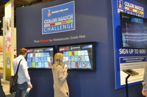 Show attendees play the touch screen game called the Color Match Challenge at the Sherwin-Williams booth. The top three fastest players won prizes each day at the show.