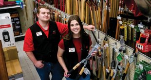Two young employees in a hardware aisle