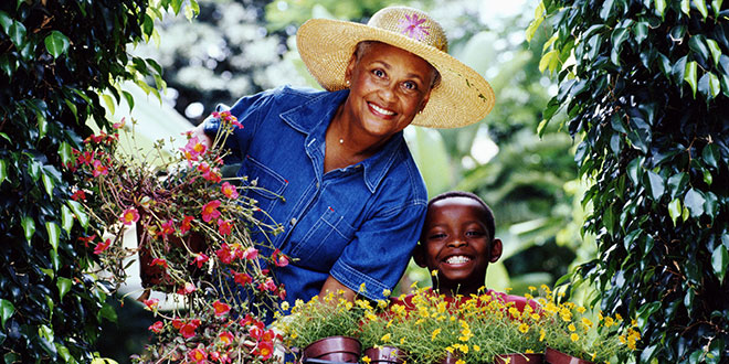 A woman and her grandson gardening