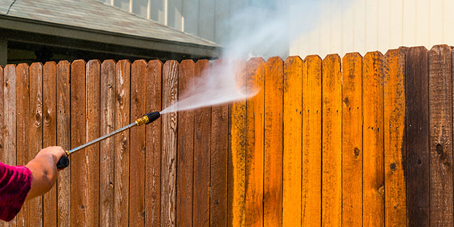 Pressure washing a fence