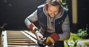DIY smiling man grinding handrail
