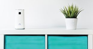 A cabinet with an air purifier on top.