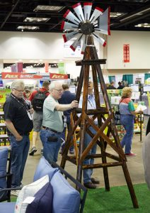 Man at Do It Best Market looking at a windmill